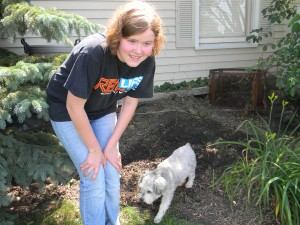 My baby girl and our dog Rylee just outside our newly planted pumpkin patch.